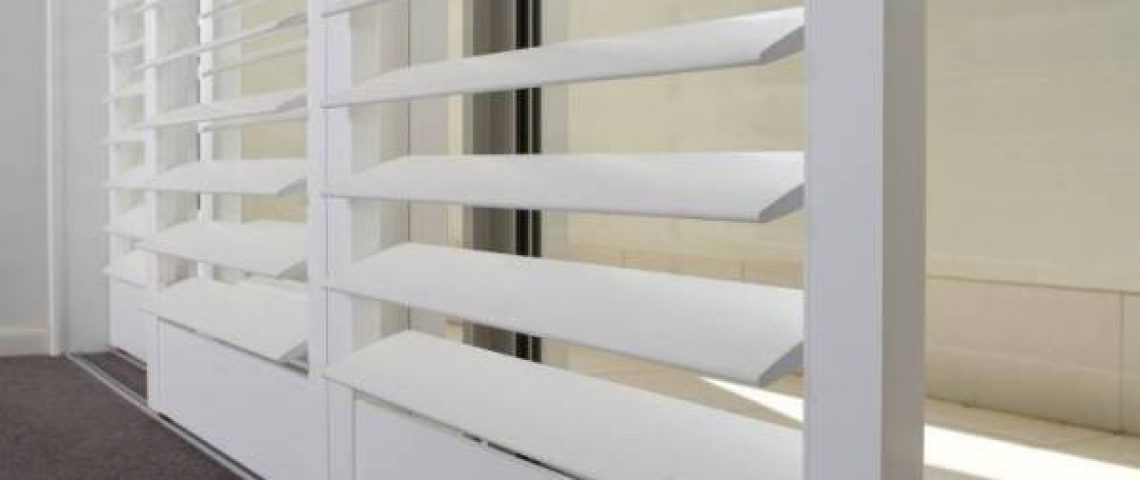White wood lore shutters close up - Love Blinds & Awnings